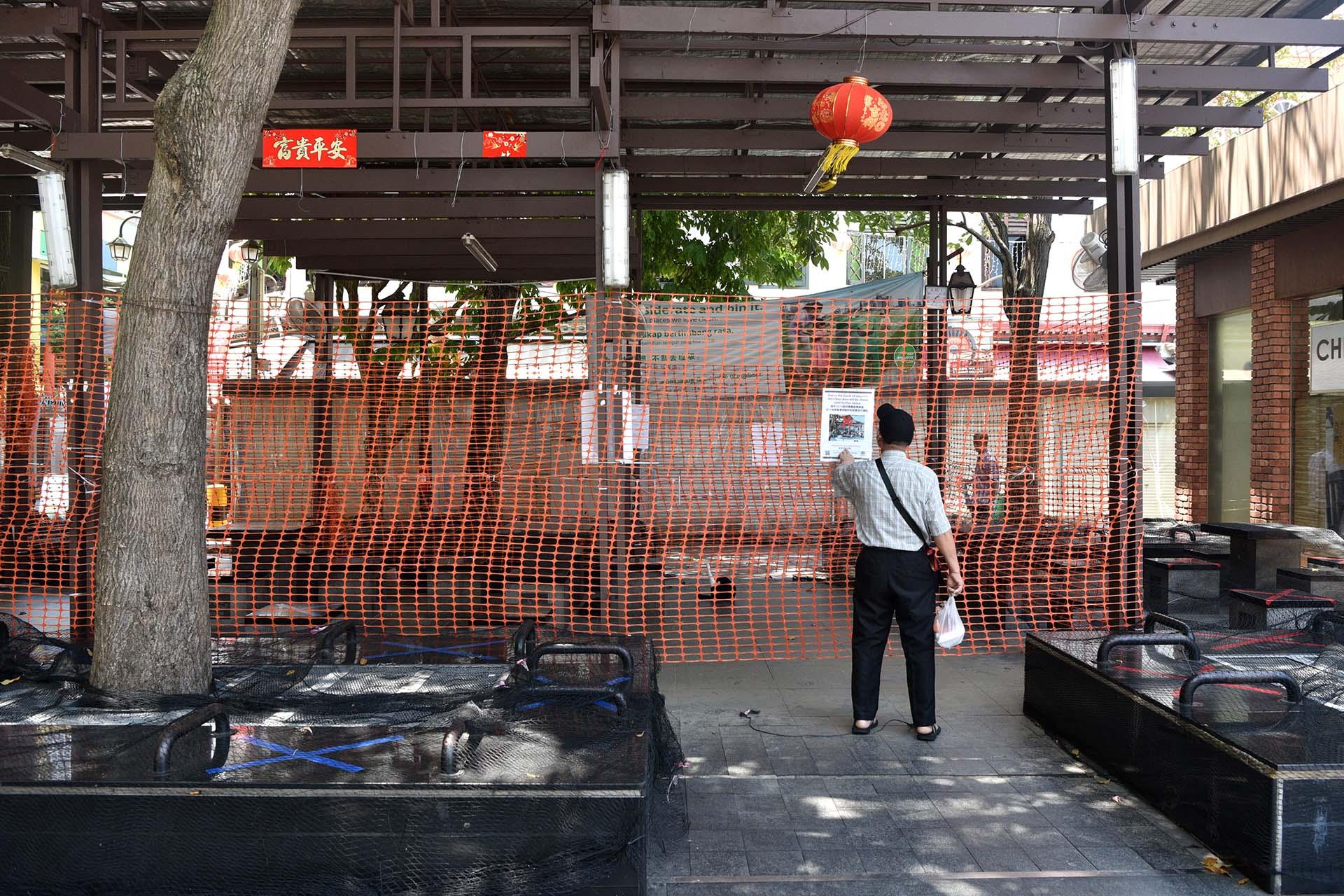 Ảnh: Người dân Singapore nghiêm chỉnh cách ly xã hội ảnh 10