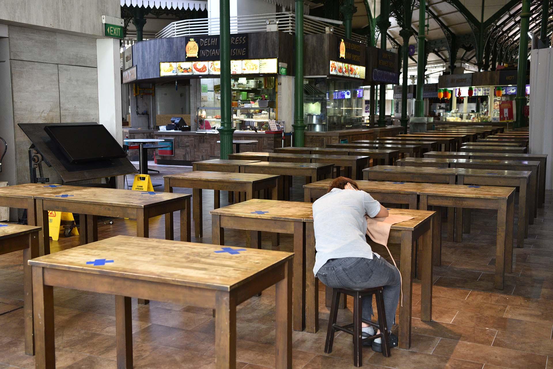 Ảnh: Người dân Singapore nghiêm chỉnh cách ly xã hội ảnh 6